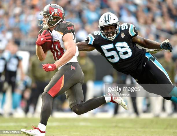 Thomas Davis of the Carolina Panthers tackles Adam Humphries of the Tampa Bay Buccaneers during their game at Bank of America Stadium on November 4...
