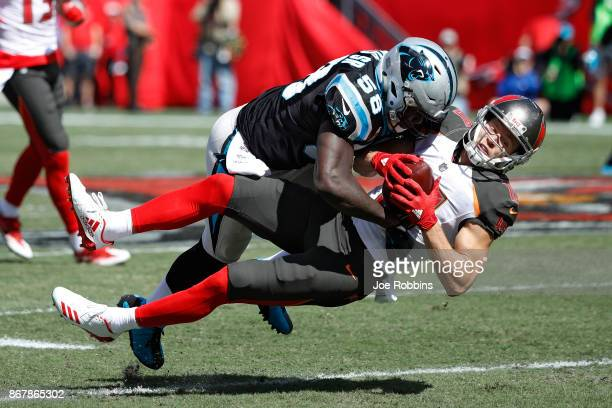 Thomas Davis of the Carolina Panthers tackles Adam Humphries of the Tampa Bay Buccaneers in the second quarter of a game at Raymond James Stadium on...