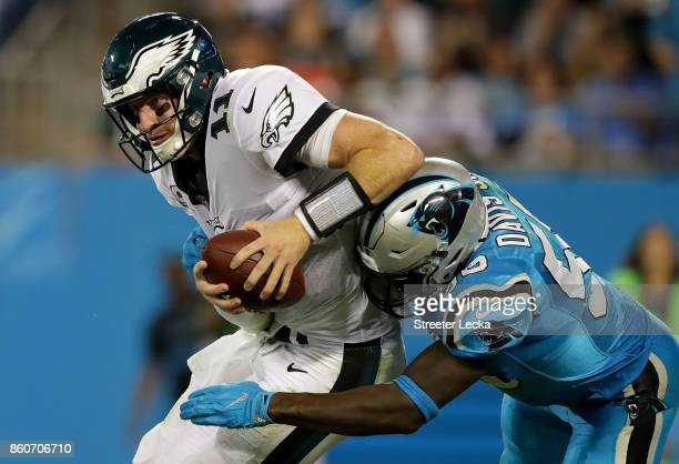 Thomas Davis of the Carolina Panthers tackles Carson Wentz of the Philadelphia Eagles during their game at Bank of America Stadium on October 12 2017...
