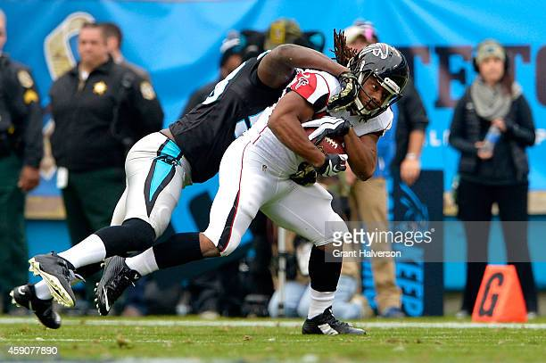 Thomas Davis of the Carolina Panthers tackles Jacquizz Rodgers of the Atlanta Falcons in the 2nd quarter during their game at Bank of America Stadium...