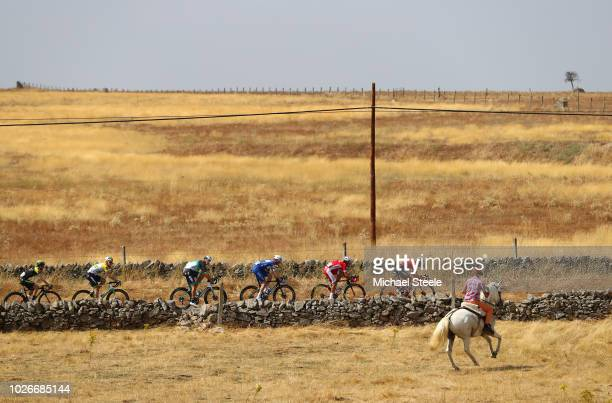 Thomas De Gendt of Belgium and Team Lotto Soudal / Stephane Rossetto of France and Team Cofidis / Kasper Asgreen of Denmarkand Team Quick-Step Floors...