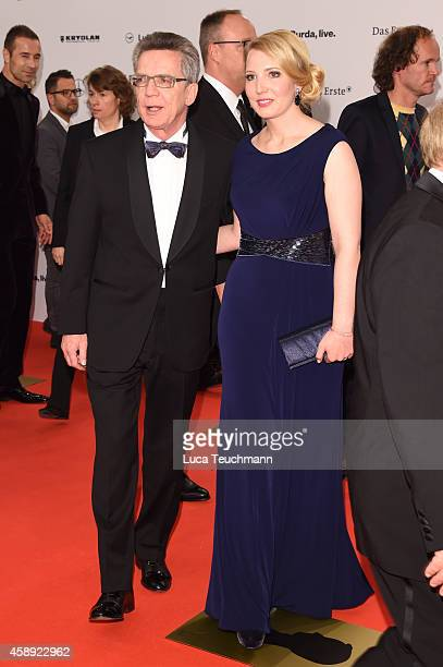 Thomas de Maiziere and his daughter Nora attend Kryolan at the Bambi Awards 2014 on November 13 2014 in Berlin Germany