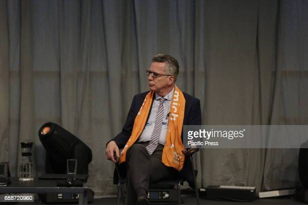 Thomas de Maiziere is pictured at the stage The Grand Imam of alAzhar Ahmed elTayeb and Thomas de Maiziere the German Federal Minister of the...