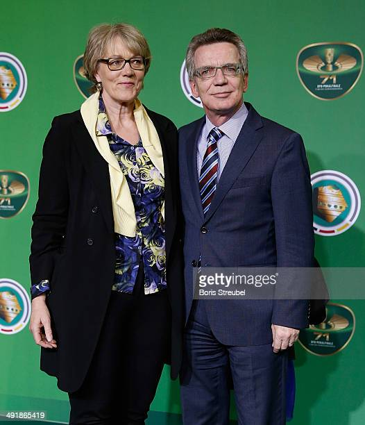 Thomas de Maiziere pose with his wife Martina de Maiziere on the green carpet prior to the DFB Cup final at Olympiastadion on May 17, 2014 in Berlin,...