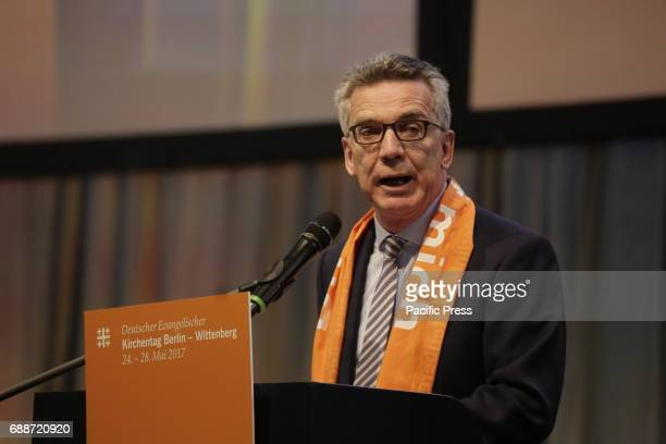 Thomas de Maiziere talks at the Kirchentag The Grand Imam of alAzhar Ahmed elTayeb and Thomas de Maiziere the German Federal Minister of the Interior...