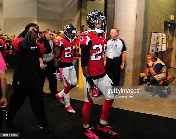 Thomas DeCoud and Robert Alford of the Atlanta Falcons head to the field before the game against the New York Jets at the Georgia Dome on October 7...