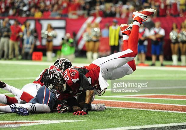 Thomas DeCoud of the Atlanta Falcons finishes a tackle against the New England Patriots at the Georgia Dome on September 29 2013 in Atlanta Georgia