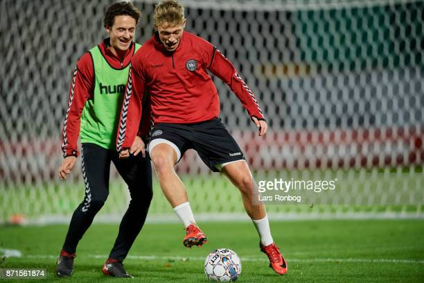 Thomas Delaney and Viktor Fischer compete for the ball during the Denmark training session at Helsingor Stadion on November 7 2017 in Helsingor...