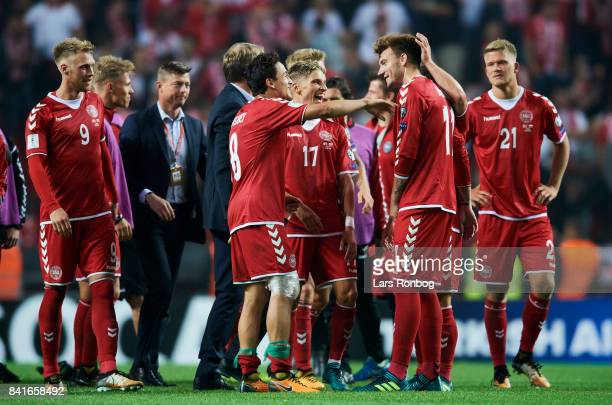 Thomas Delaney Jens Stryger Larsen and Nicklas Bendtner of Denmark celebrate after the FIFA World Cup 2018 qualifier match between Denmark and Poland...