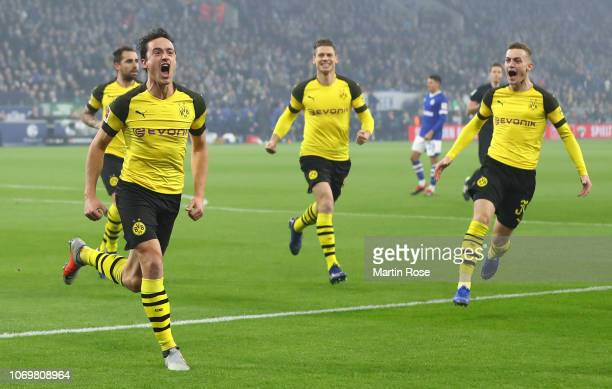 Thomas Delaney of Borussia Dormund celebrates after scoring his team's first goal with his team mates during the Bundesliga match between FC Schalke...
