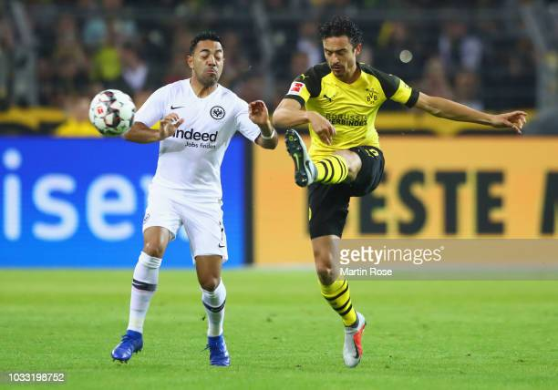 Thomas Delaney of Borussia Dortmund and Marco Fabian of Eintracht Frankfurt battle for possession during the Bundesliga match between Borussia...