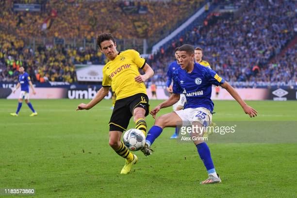 Thomas Delaney of Borussia Dortmund battles for possession with Amine Harit of FC Schalke 04 during the Bundesliga match between FC Schalke 04 and...