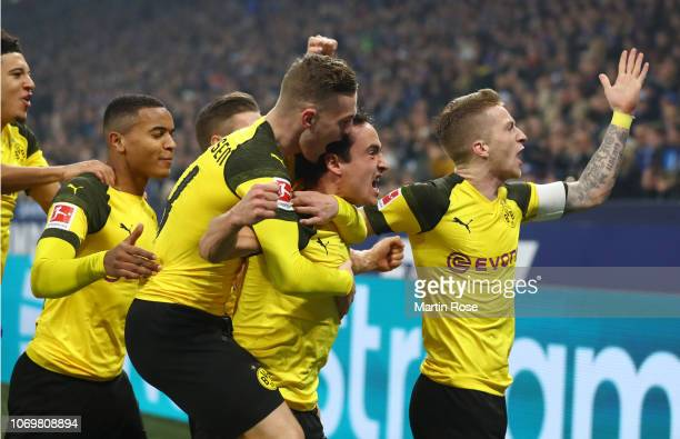 Thomas Delaney of Borussia Dortmund celebrates after scoring his team's first goal with his team mates during the Bundesliga match between FC Schalke...