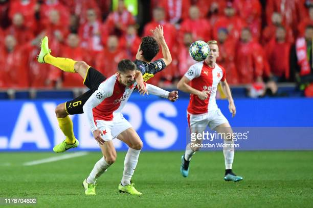 Thomas Delaney of Borussia Dortmund challenges for the high ball with Lukas Masopust of Slavia Praha during the UEFA Champions League group F match...