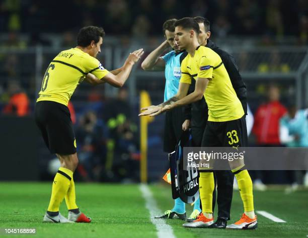 Thomas Delaney of Borussia Dortmund is replaced by substitute Julian Weigl of Borussia Dortmund during the Group A match of the UEFA Champions League...