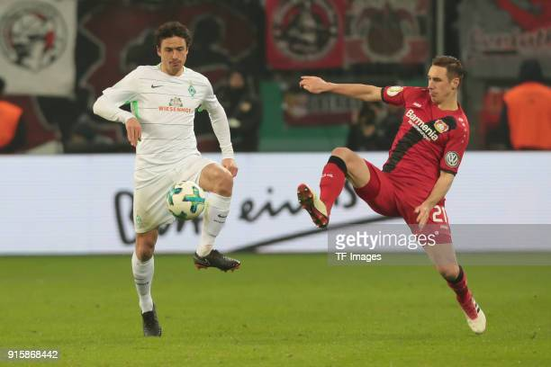 Thomas Delaney of Bremen and Dominik Kohr of Leverkusen battle for the ball during the DFB Cup match between Bayer Leverkusen and Werder Bremen at...