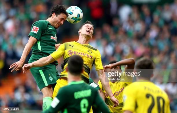 Thomas Delaney of Bremen and Lukasz Piszczek of Dortmund head for the ball during the Bundesliga match between SV Werder Bremen and Borussia Dortmund...