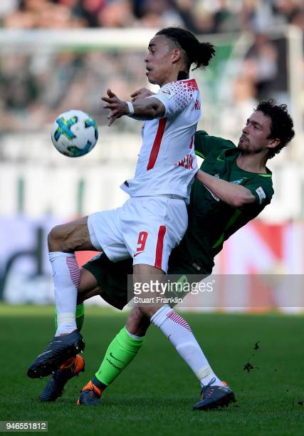 Thomas Delaney of Bremen and Yussuf Poulsen of Leipzig battle for the ball during the Bundesliga match between SV Werder Bremen and RB Leipzig at...