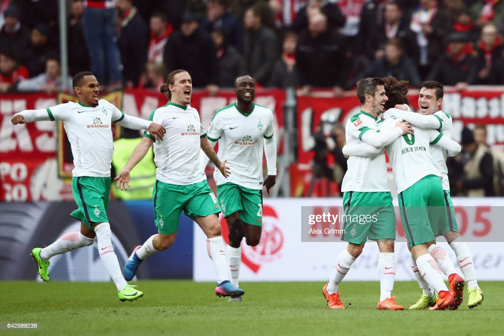 Thomas Delaney #6 of Bremen celebrates his team's second goal with team mates during the Bundesliga match between 1. FSV Mainz 05 and Werder Bremen at Opel Arena on February 18, 2017 in Mainz, Germany.