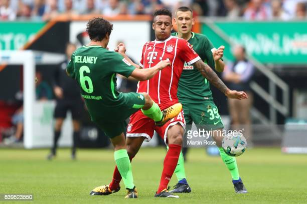 Thomas Delaney of Bremen fights for the ball with Tolisso of Bayern Muenchen during the Bundesliga match between SV Werder Bremen and FC Bayern...