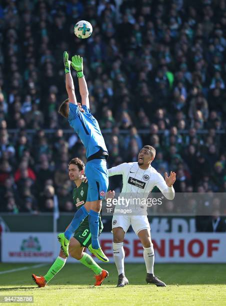 Thomas Delaney of Bremen Goalkeeper Lukas Hradecky of Frankfurt and Simon Falette of Frankfurt in action during the Bundesliga match between Werder...