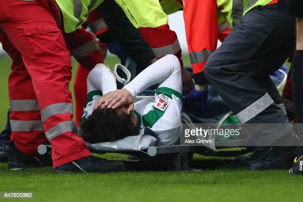 Thomas Delaney of Bremen is carried off on a stretcher during the Bundesliga match between 1 FSV Mainz 05 and Werder Bremen at Opel Arena on February...