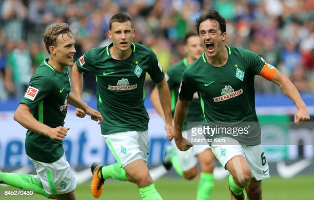 Thomas Delaney of Bremen jubilates with team mates after scoring the second goal during the Bundesliga match between Hertha BSC and SV Werder Bremen...