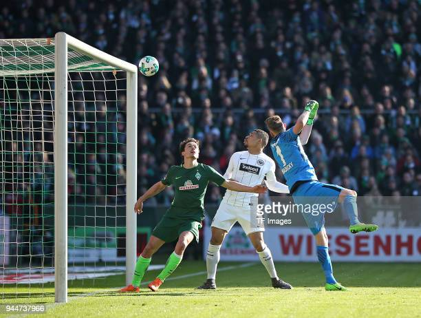 Thomas Delaney of Bremen Simon Falette of Frankfurt and Goalkeeper Lukas Hradecky of Frankfurt in action during the Bundesliga match between Werder...