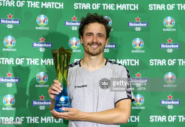 """Thomas Delaney of Denmark poses for a photograph with their Heineken """"Star of the Match"""" award after the UEFA Euro 2020 Championship Quarter-final..."""