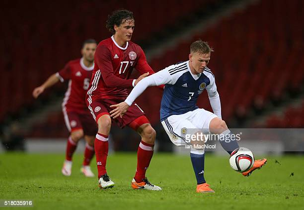 Thomas Delaney of Denmark vies with Matt Ritchie of Scotland during the International Friendly match between Scotland and Denmark at Hampden Park on...