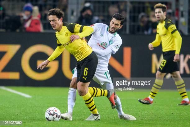 Thomas Delaney of Dortmund battles for the ball with Nuri Sahin of Bremen during the Bundesliga match between Borussia Dortmund and SV Werder Bremen...