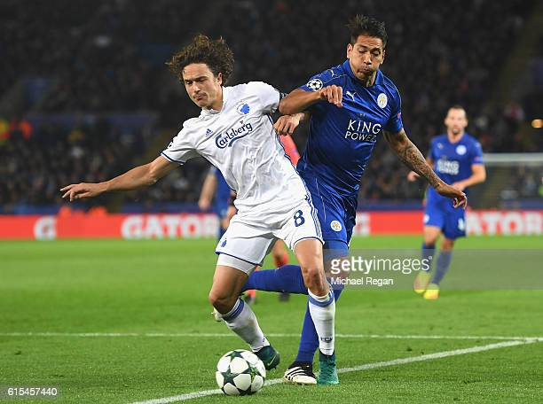Thomas Delaney of FC Copenhagen and Leonardo Ulloa of Leicester City compete for the ball during the UEFA Champions League Group G match between...
