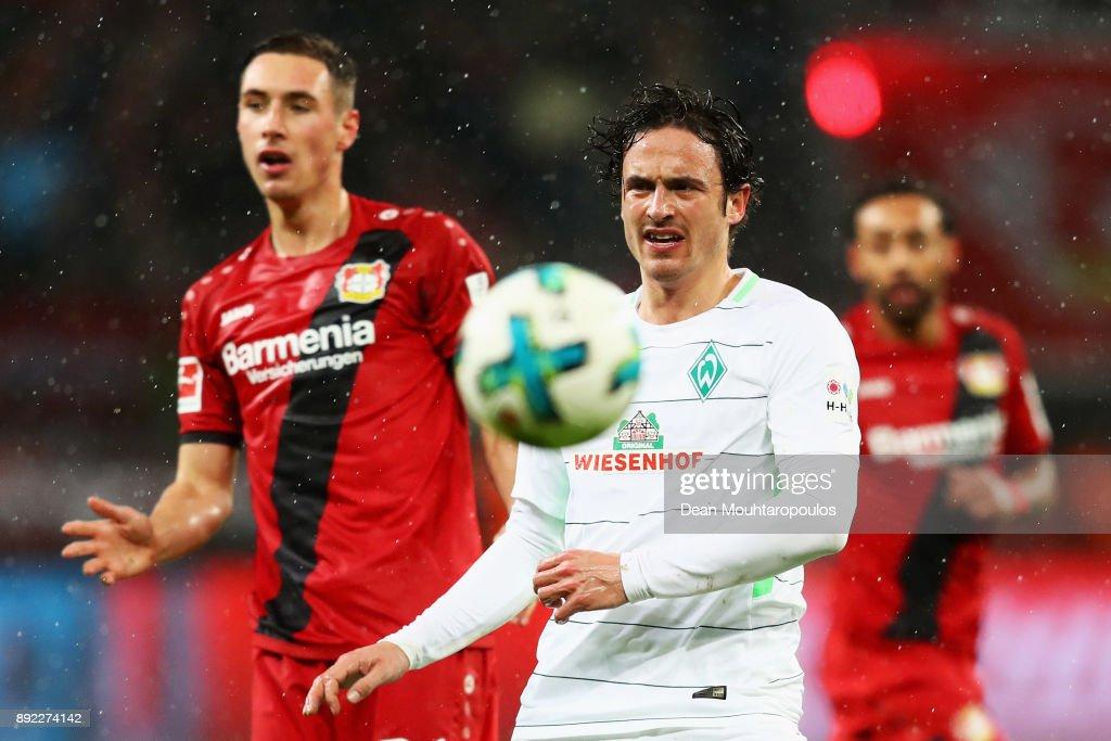 Thomas Delaney of Werder Bremen in action against Dominik Kohr of Bayer 04 Leverkusen during the Bundesliga match between Bayer 04 Leverkusen and SV Werder Bremen at BayArena on December 13, 2017 in Leverkusen, Germany.