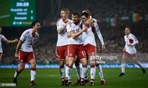 Thomas Delaney Simon Kjar Andreas Bjelland and Andreas Christensen of Denmark celebrate after scoring their first goal during the FIFA 2018 World Cup...