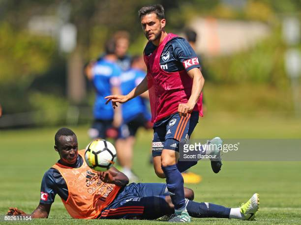 Thomas Deng and Matias Sanchez of the Victory compete for the ball during a Melbourne Victory ALeague training session at Gosch's Paddock on October...
