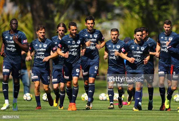 Thomas Deng James Troisi Carl Valeri Pierce Waring Kosta Barbarouses Christian Theoharous and Mitch Austin of the Victory run during a Melbourne...
