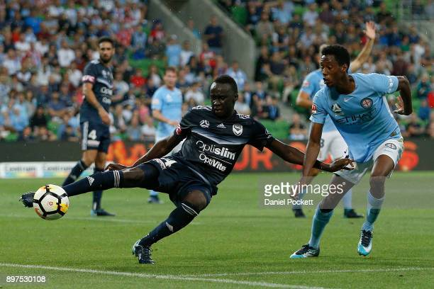 Thomas Deng of the Victory and Bruce Kamau of Melbourne City contest the ball during the round 12 ALeague match between Melbourne City and Melbourne...