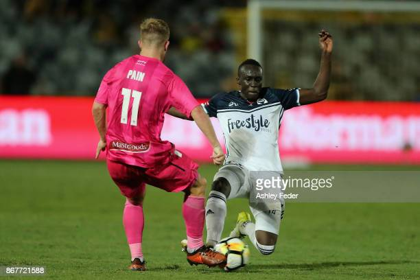 Thomas Deng of the Victory contests the ball against Connor Pain of the Mariners during the round four ALeague match between the Central Coast...