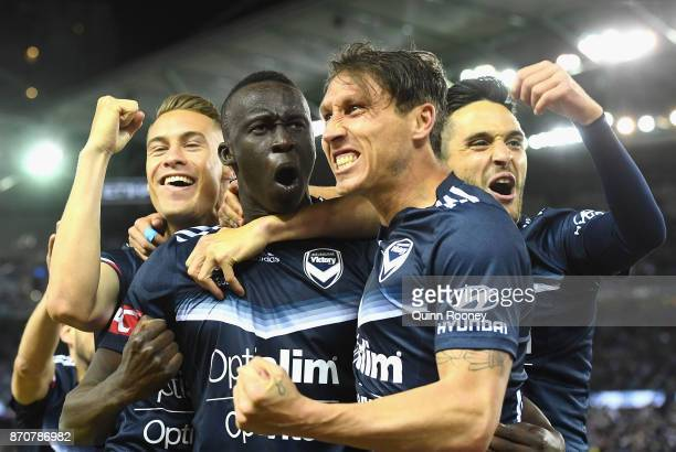 Thomas Deng of the Victory is congratulated by team mates after scoring a goal during the round five ALeague match between the Melbourne Victory and...