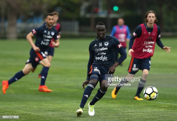 Thomas Deng of the Victory kicks the ball during a Melbourne Victory ALeague training session at Gosch's Paddock on October 26 2017 in Melbourne...