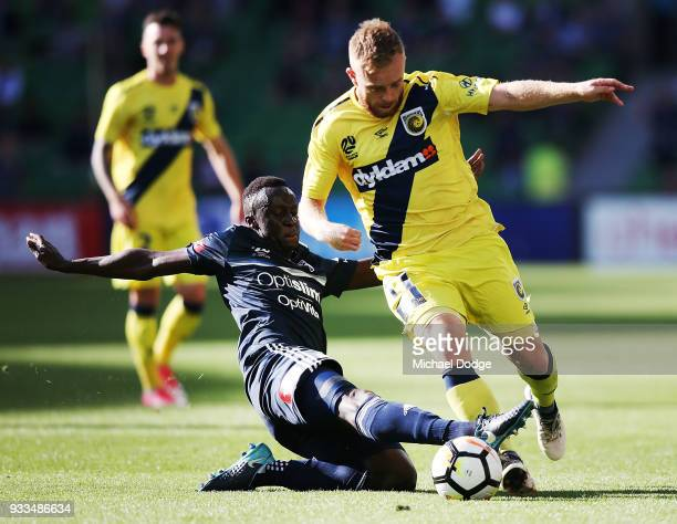 Thomas Deng of the Victory tackles Connor Pain of the Mariners during the round 23 ALeague match between the Melbourne Victory and the Central Coast...