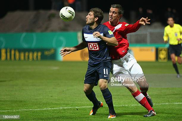 Thomas Denker of Essen and Tunay Torun of Berlin go up for ea header during the second round DFB Cup match between RotWeiss Essen and Hertha BSC...