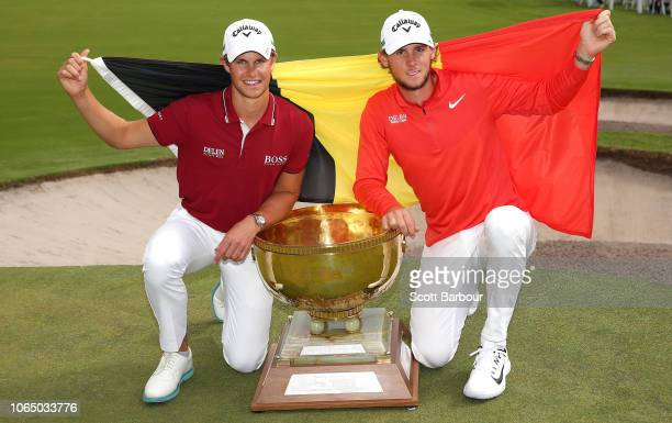 Thomas Detry and Thomas Pieters of Belgium pose with the World Cup trophy after winning the event during day four of the 2018 World Cup of Golf at...