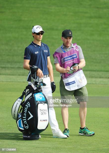 Thomas Detry of Belgium and his caddie look along the 9th hole fairway during the final round on day four of the Omega Dubai Desert Classic at...