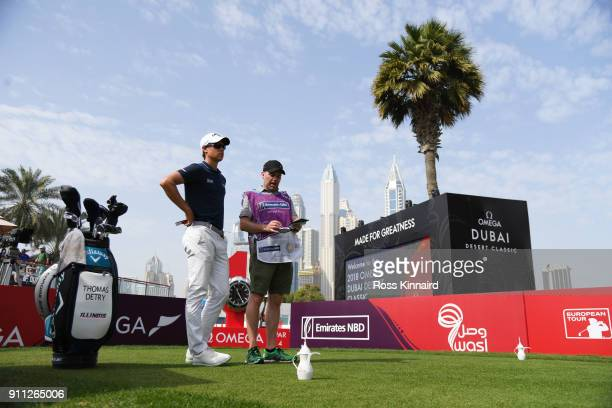 Thomas Detry of Belgium and his caddie look on from the 1st tee during the final round on day four of the Omega Dubai Desert Classic at Emirates Golf...