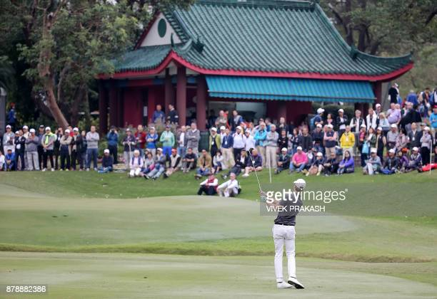 Thomas Detry of Belgium chips onto the 10th green during round three of the Hong Kong Open tournament at the Hong Kong Golf Club on November 25 2017...