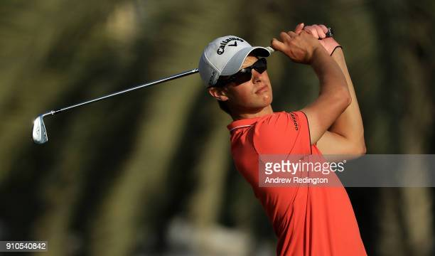 Thomas Detry of Belgium hits his tee shot on the 15th hole during round two of the Omega Dubai Desert Classic at Emirates Golf Club on January 26...