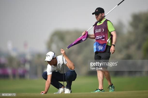 Thomas Detry of Belgium lines up a putt on the 1st green during the second round of the Commercial Bank Qatar Masters at Doha Golf Club on February...