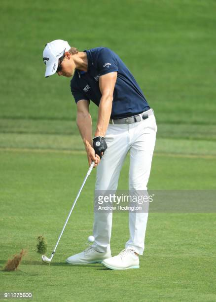 Thomas Detry of Belgium plays his second shot on the 9th hole during the final round on day four of the Omega Dubai Desert Classic at Emirates Golf...