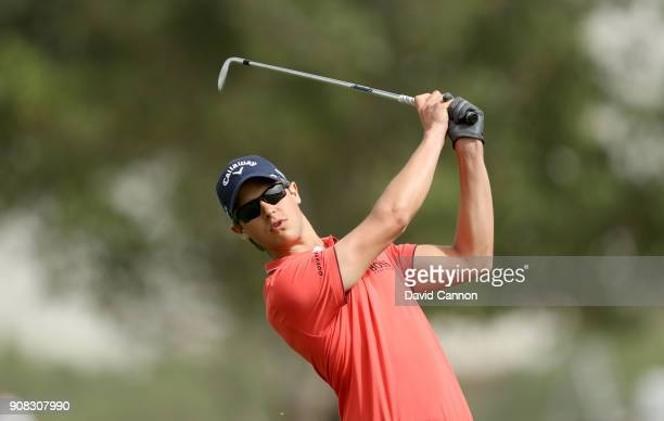 Thomas Detry of Belgium plays his second shot on the first hole during the final round of the Abu Dhabi HSBC Golf Championship at Abu Dhabi Golf Club...